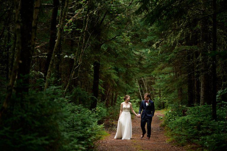 Couple walking in the woods - Wedding Photographer